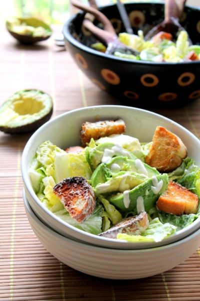 Vegan caesar salad with avocado and garlic croutons