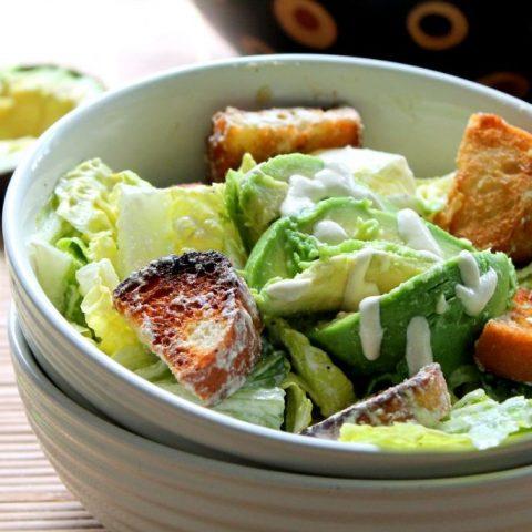 vegan caesar salad with avocado and garlic croutons