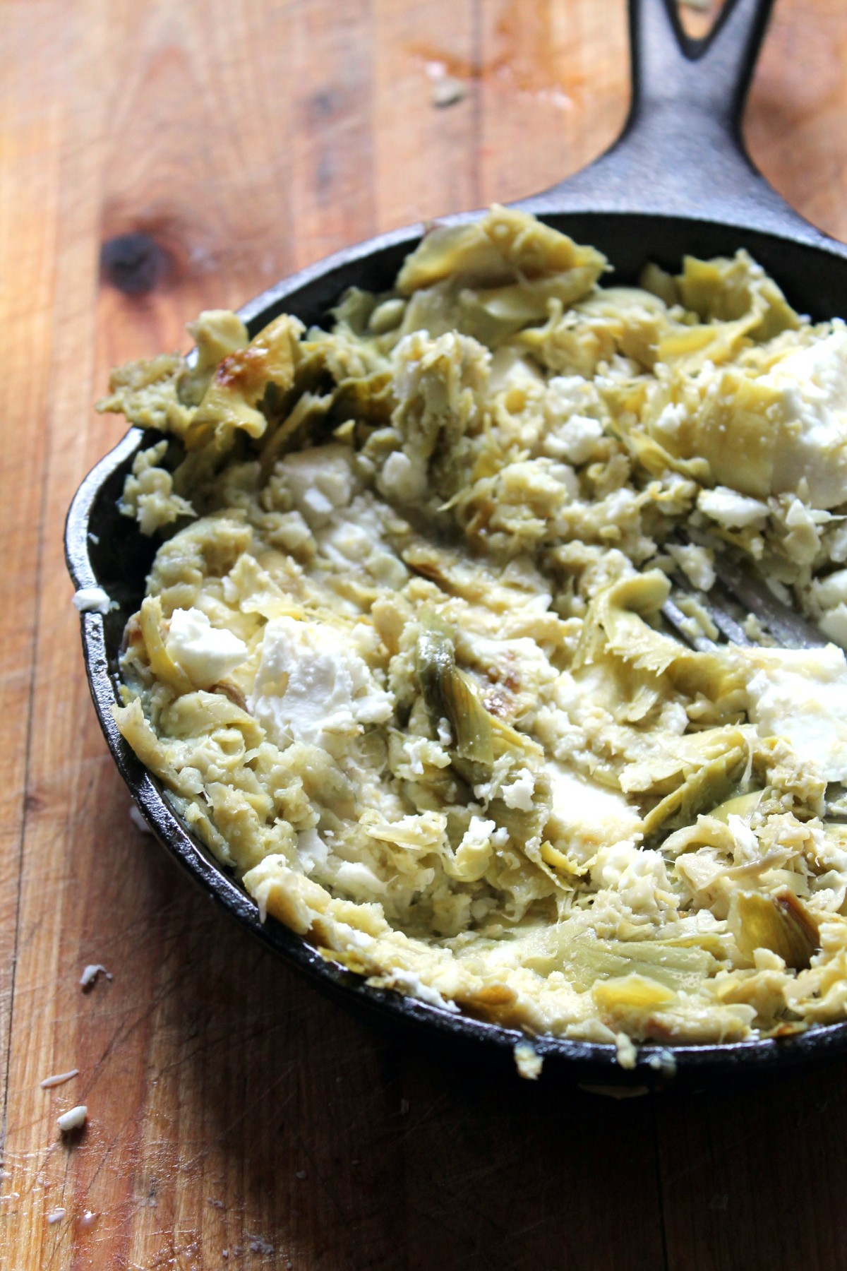 Simple feta and artichoke dip. 6 ingredients and nothing to chop! Much lighter than the usual artichoke dip, but I think it's actually tastier!
