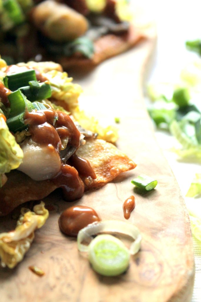Delicious fusion tostadas with beer battered avocado, drunken mushrooms, slaw and peanut sauce. We had such a great time making these.