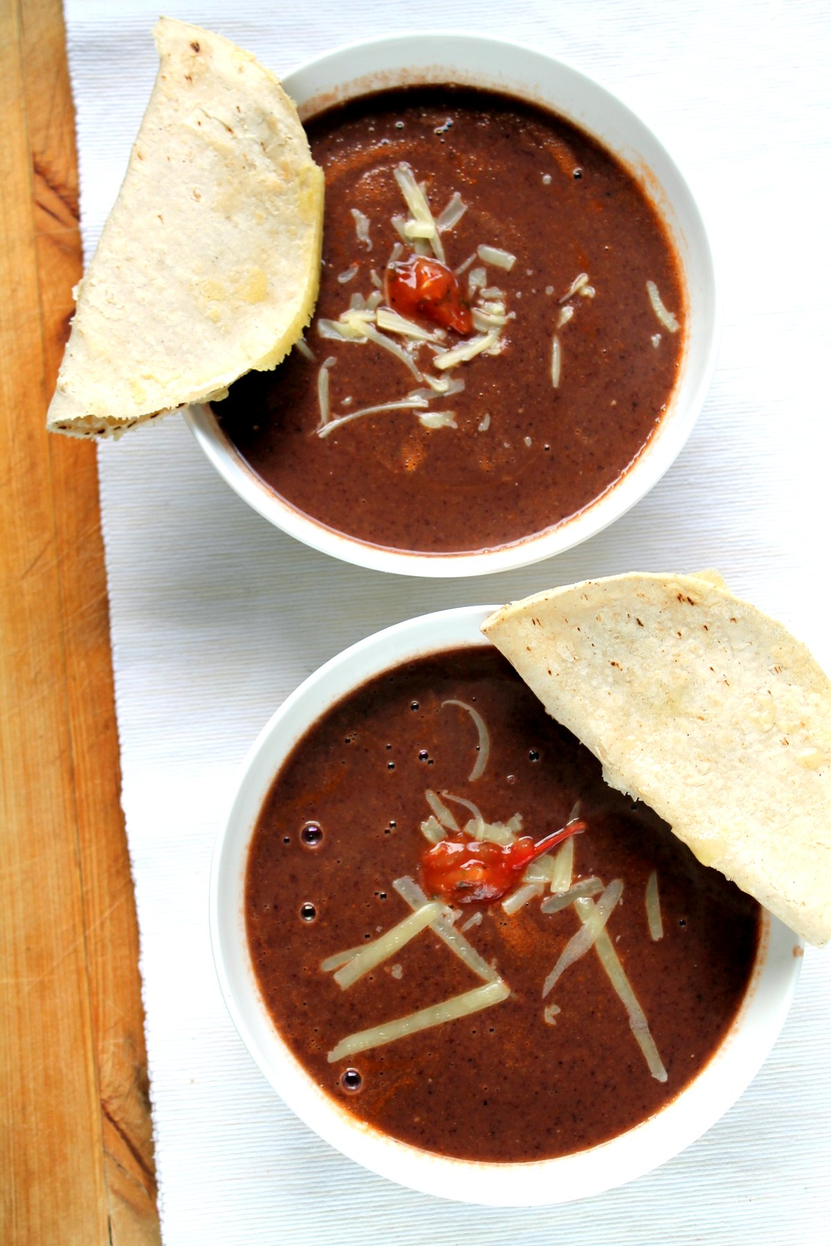 A 5 ingredient, 15 minute dinner! This is the easiest black bean soup you'll ever make, and the quick quesadilla dippers come together while it heats up. You just can't go wrong with this easy, healthy dinner!