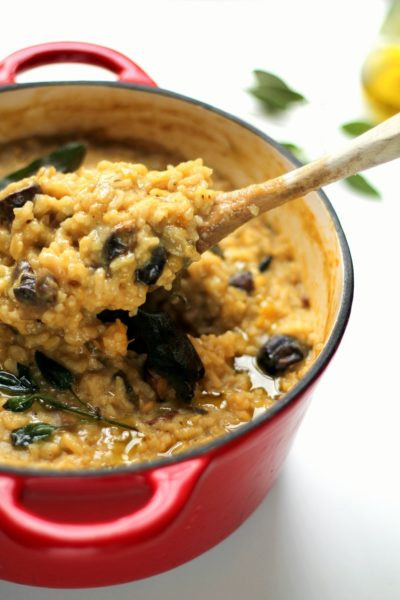 This vegan risotto is baked in a dutch oven with roasted autumnal veggies, sage and a drizzle of truffle oil. So tasty and creamy, you will not miss the cheese!