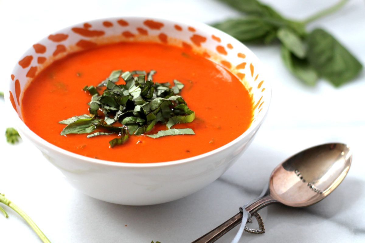This dairy free tomato soup is incredibly rich and creamy thanks to the addition of roasted garlic! Vegan and gluten free, a total crowd pleaser.