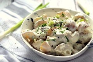 This greek yogurt potato salad is such a hit at BBQs! It's easy to make and the silky greek yogurt packs a real punch. I also love to serve this potato salad still warm!