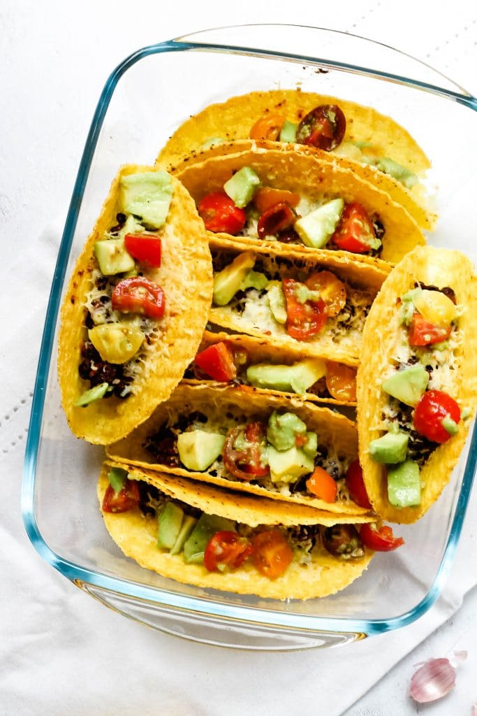 Oven baked tacos with salsa topping.