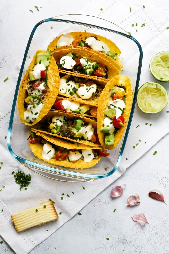 Oven baked bean and cheese tacos with a variety of toppings