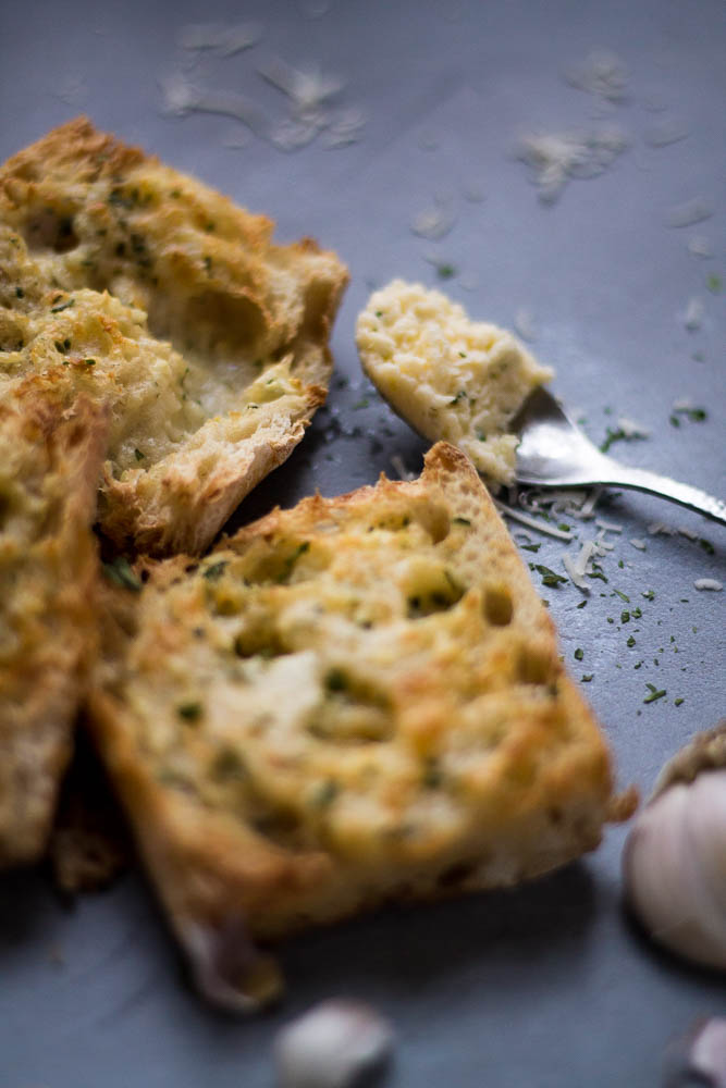 Air fryer garlic bread with focus on the garlic butter