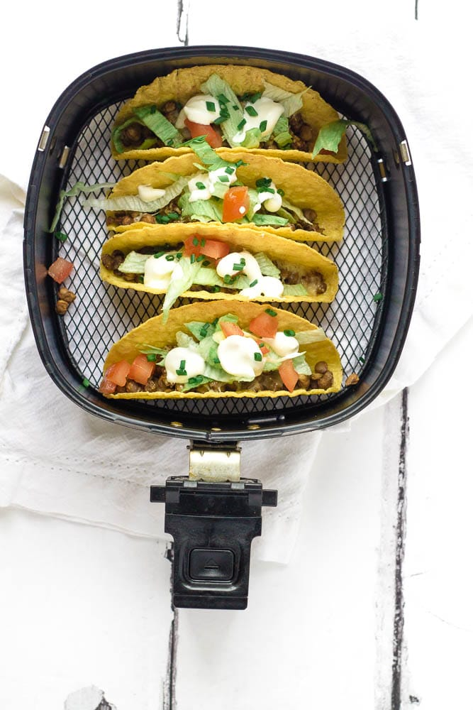 Air fried tacos with a variety of toppings.