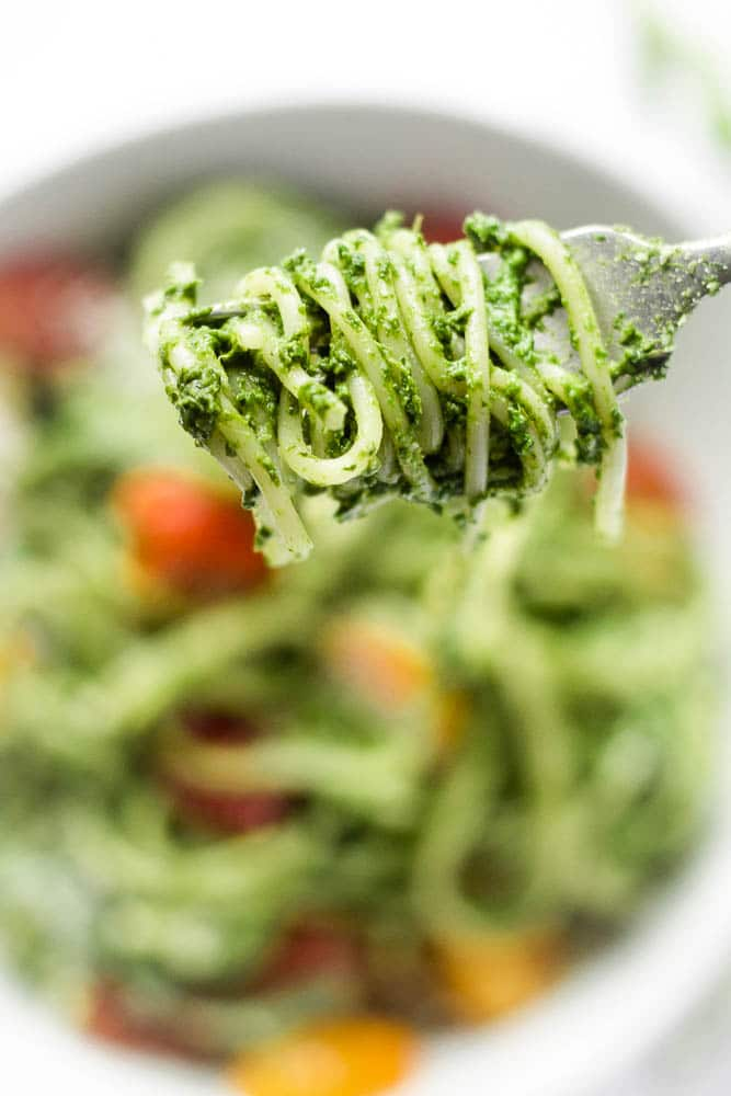A forkful of spinach spaghetti.